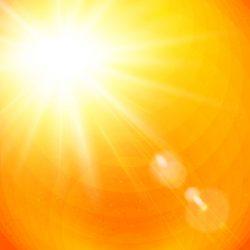 Vivid orange sunburst with sun flare